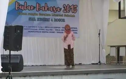 mengaktifkan Literasi di SMAN 4 Kota Bogor sebagai 'Sekolah Rujukan'.